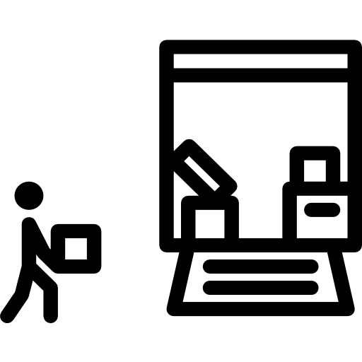 A simple icon of a workman loading a van with furniture.